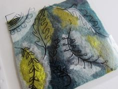 Dog-Daisy Chains: textiles  Putting felt pieces in a plastic sleeve and practicing decorations