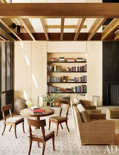 A bespoke games table is paired with a suite of Mirak side chairs   archdigest.com