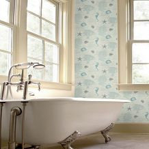 A textured blown vinyl wallcovering featuring an all over design of script, shells and sea creatures. Shown here in aqua. Other colourways are available. Please request a sample for a true colour match.