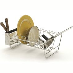 Drain dishes inside the sink with our Endurance® In-Sink Dish Rack by RSVP International. Efficiently sized for placement in the kitchen sink, this sink dish rack comfortably holds pots and pans and even accommodates large size chargers. Constructed from stainless steel tubular wire, this sink dish rack has clear acrylic feet to protect the sink bottom. This stainless steel sink dish rack includes a removable 3-section cutlery basket that hangs on the end.