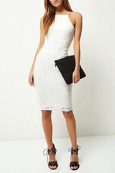 What's trending for prom 2016? Short dresses! A shorter hemline is fun, flirty and perfect if you want to rock the night away on the dance floor. Try on this hot white lace bodycon dress–a great prom dress alternative for just $76!