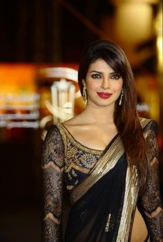Plain saree with gold border and a gorgeous, printed, full sleeved blouse. <3 ---- Worn by priyanka chopra