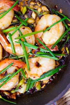 A simple, delicious tapa, Gambas al Ajillo can be made in a few minutes with garlic, shrimp, olive oil and chile peppers. This version adds garlic scapes to the mix for color and flavor.