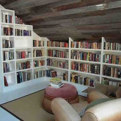 Custom Built-In Bookcases And Old Barn Wood Ceiling