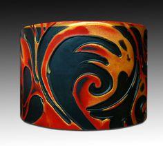 Golden flames polymer clay cuff. $16.00, via Etsy.