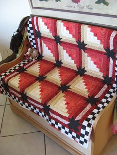 Patriotic log cabin quilt used as a bench cushion at Blissfully Imperfect