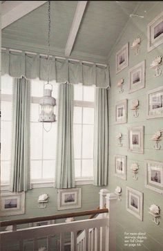 Cottage with green walls, exposed rafters, love the lantern, white frames