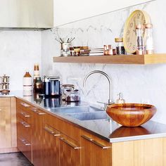 ... dishwasher, oven, coffee machine and hand-beaten copper sink. Via john