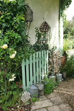 Entry gate with garden art (2) by KarlGercens.com, via Flickr