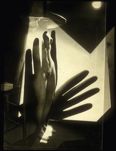 Maurice Tabard   Composition, 1929   This photo is informed by the artist's experiences as an advertising photographer, X-ray technician, and assistant to Man Ray. By printing through a sandwich of several negatives, Tabard fabricated a nude that inhabits no definable space or time. She is at once Pygmalion's Galatea or Botticelli's Venus while remaining a Parisian model who has just stripped off her stockings.