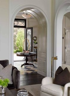 House Tour: Connecticut Shore Rounded archways, white wood, alternating black and white tiles - Model Home Interior Design Design Entrée, House Design, Design Ideas, Rustic Design, Food Design, Design Projects, Style At Home, British Colonial Decor, British Home Decor