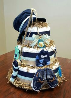 Fishing themed diaper cake,  baby boy, baby shower gift. More photos on my Facebook,  Simply Showers. https://m.facebook.com/adorablegifts