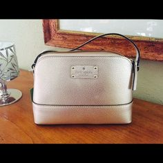 """Kate Spade Hanna Beautiful rosegold Kate Spade Hanna With adjustable shoulder strap. Zip top closure with a roomy interior that offers a multi function pocket. 9.25"""" x 6.75"""" high x 3"""". NWT. NO TRADES kate spade Bags Shoulder Bags"""