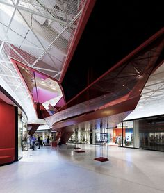 Monumental And Golden Emporia Shopping Mall With Curved Glass Facade