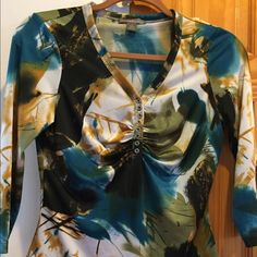 Multi-Colored V-Neck Top by Metric Multi-Colored V Neck Top by Metric-colors blue, green, white, gold and black size is small. Can be worn all year, condition is excellent. Metric Tops Blouses