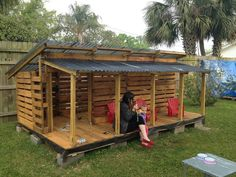 The most adorable Pallet Playhouse! More photos inside! #Palletplayhouse #outsideplayhouse