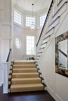Design Chic - gorgeous staircase and love the round window