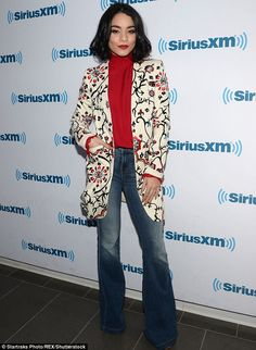 Like my look?The High School Musical vet looked fashionable in a red turtleneck top with embroidered coat with a red, blue and black floral pattern
