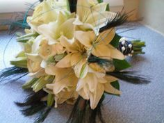 Off white navy and peacock feathers. Bridal boquet