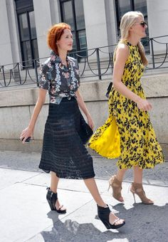 Taylor Tomasi Hill (left) proved her style versatility once again, slipping into a tropical-print button-down, textured midi skirt, and cutout wedges. Her equally stylish companion made the rounds in a printed dress and lace-up heels.