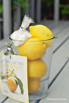 Fill a glass pitcher with lemons, then attach a  a stylish dish towel or what not to the handle — the makings for lemonade. Include a simple recipe that doubles as a gift tag.