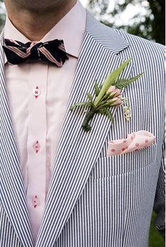 LOVE the navy/white seersucker. Add different flower - peony (or no flower) and not polka dotted pocket square, light pink shirt or white and darker pink bowtie.