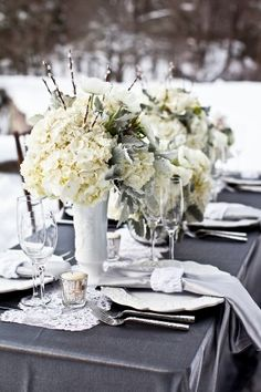 silver tablecloth + white and gray flowers + mercury glass votives = perfection