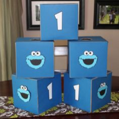 Cookie monster birthday theme Centerpieces using die cut cookie monster faces and cardboard box