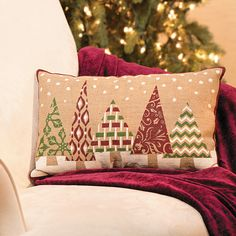 "Spruce up any room with this joyous and warm holiday throw pillow. It features lovely green and red trees in dazzling designs on a burlap style cloth. Place it on benches, chairs, or beds to bring the warmth of Christmas spirit into your home. For decorative use only. Imported. 13"" x 20"" $14.00 1 Piece(s) for Loveseat..Christmas"