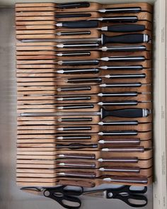 In-drawer wooden knife trays save counter space.