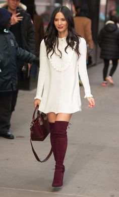 Olivia Munn in a cream mini with burgundy suede boots and matching bag