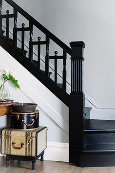 Black paint in a home is a conversation starter and adds a bold twist to the elements of a typical home. it's not white, gray, tan, or another typical color. stairs 5 Places To Use Black Paint In Your Home Painted Banister, Black Stair Railing, Black Staircase, Painted Staircases, Staircase Railings, Banisters, Staircase Design, Stairways, Black Painted Stairs