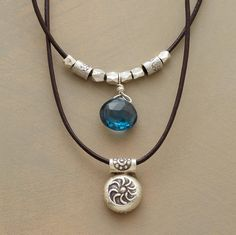 sun and sky necklace London blue topaz is a patch of clear sky; companion charm stamped with the sun's wavy rays. Two leather strands, one strung with Thai silver beads, secure with hook clasp.