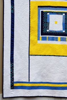Yellow and blue quilt.