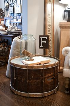 A drum as a table is a genius home decor idea... we love this!