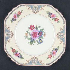 """Chateau"" china pattern with ecru rim, pastel flowers, & pastel turquoise blue accents from Wedgwood."