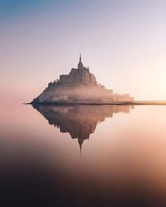 Mont Saint-Michel is a rocky tidal island located in Normandy, at the mouth of t . - Home Decor Monuments, Mont Saint Michel France, Places To Travel, Places To Visit, Destinations, Travel Abroad, Best Vacations, Land Scape, Strand