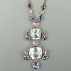 An early 20th century arts and crafts aquamarine and sapphire pendant,
