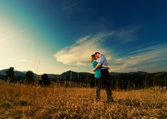 white-ranch-park-golden-colorado-mountain-sunset-engagement-photography-vibrant-setting-kiss