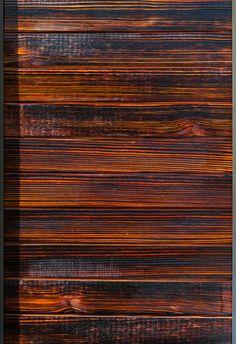 Charred wood siding: Japanese shou-sugi-ban (blowtorch) method.