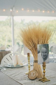 wheat table centerpieces http://www.weddingchicks.com/2013/11/20/cozy-country-wedding/