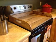 Nice idea, when things get left on the stove, move it all at once. Kitchen Stove, Diy Kitchen, Kitchen Decor, Kitchen Ideas, Wooden Stove Top Covers, Stove Covers, Stove Board, Brunswick House, Sink Cover