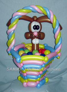 """An Easter bunny basket. Everyone was very """"hoppy"""" with this wonderful centerpiece.           www.sammyjballoons.com"""