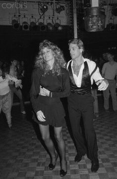 Studio 54, Farrah Fawcett Dancing with Ryan O'Neal. What a journey they had! Follow RUSHWORLD on Pinterest. Always something you'll love!