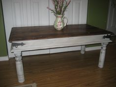 """One of my favorite pieces to paint! This is the second one that I have been lucky enough to obtain. I love the style of these tables with their riveted tops and hammered metal brackets on the sides. I have stripped & restained the top in a coat of provincial stain then added a """"faded"""" handpainted vintage postage graphic. Finished in protective coats of clear varnish. The sides and legs are finished in layered chalk paint colors of french grey, antique white and white...distressed & waxed."""