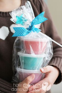 Favors...homemade playdough in small little tupperware cups with lids! (also could be good for Christmas gifts for kids' friends)