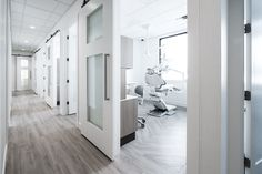 Clean and sleek dental office design with an A-dec 500 dental chair