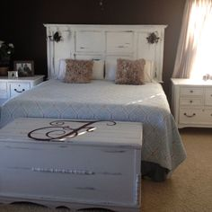Our custom painted headboard we did and we added Ballard Design sconces to make it even more fabulous!! Love my oversized monogrammed cedar chest too :)
