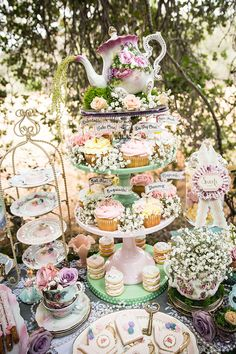 How reminiscent of Alice in Wonderland is this decked out tea party sweets table??