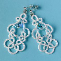 http://littleblacklace.com/2012/02/05/off-white-handmade-earrings-lace-svarowski-wedding-jeweller/